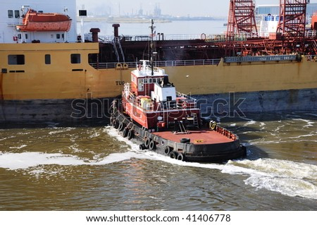 chemical tanker entering the port - stock photo