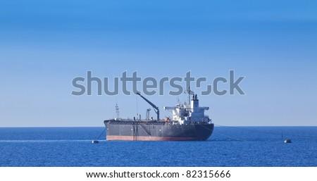 Chemical tanker in harbor - stock photo