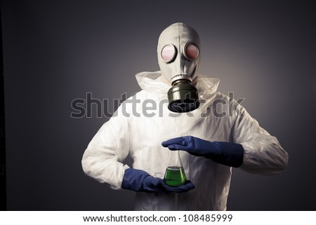 chemical warfare concept with man in a gas mask - stock photo