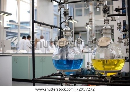 Chemicals stored in laboratory - stock photo
