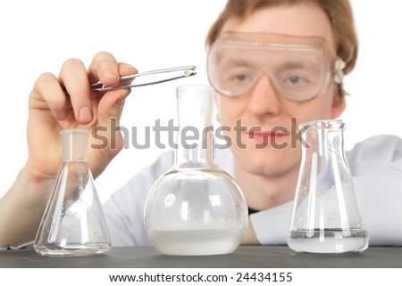 Chemist and three flasks - stock photo