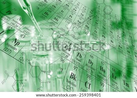 Chemist dropping reagent to the test tubes with periodic table and chemical structure background at laboratory - stock photo