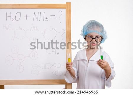 Chemist girl in points and with two tubes at board - stock photo
