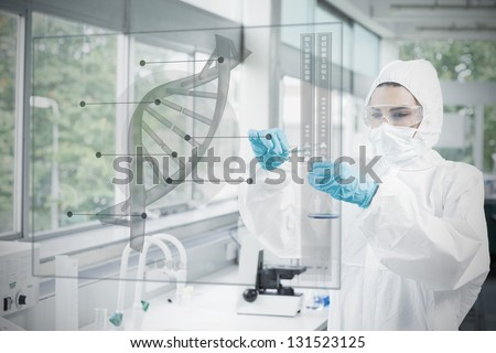 Chemist in protective suit working with futuristic interface with dna diagram on it