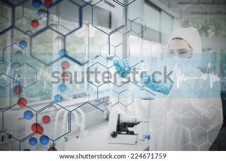 Chemist in protective suit working with futuristic interface with formula diagram against dna helix in blue and red with ecg line - stock photo