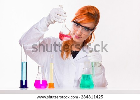 Chemist looks at the glass in the lab - studio shoot