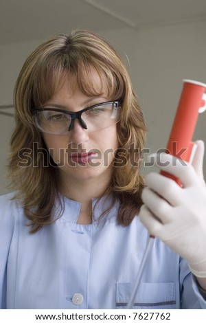 chemist preparing a sample - stock photo