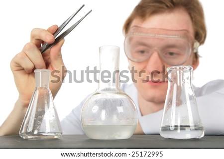 Chemist with tweezers and three flasks - stock photo