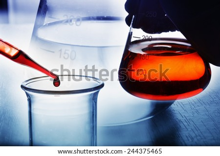 chemistry experiment at science lab - stock photo
