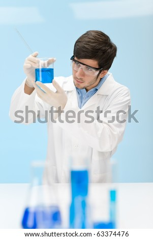 Chemistry experiment -  scientist in laboratory, wear protective eyewear