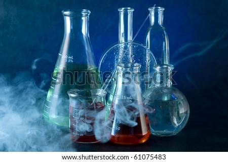 Chemistry flask on the dark background - stock photo
