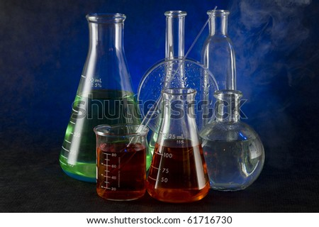 Chemistry flask on the dark background