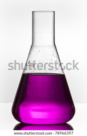 chemistry glass with toxic violett liquid on white ground - stock photo