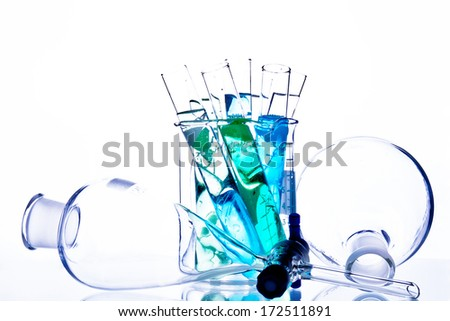 Chemistry glassware with test tubes and beaker. - stock photo