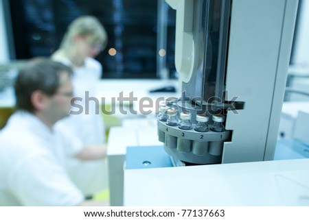 chemistry lab (shallow DOF; selective focus; color toned image) - stock photo