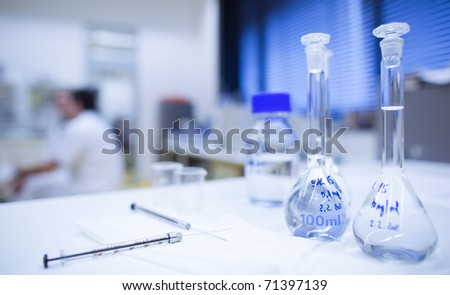 chemistry research center lab (shallow DOF; focus on the glassware in the foreground) - stock photo