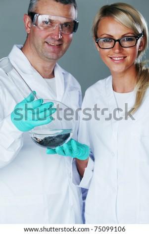 Chemistry researchers - stock photo