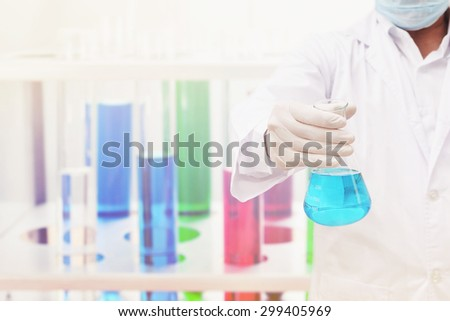 chemistry researching at science lab - stock photo
