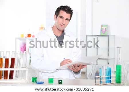 Chemistry student performing a series of tests - stock photo