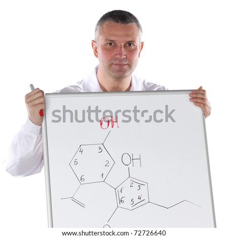Chemistry teacher presenting formula of organic chemical compound - stock photo