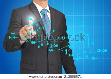 chemistry teacher writing science and chemical formula  - stock photo