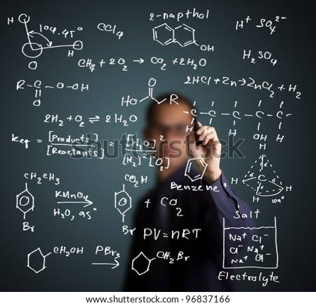 chemistry teacher writing science and chemical formula on whiteboard - stock photo