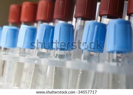 Chemistry test tubes in a row - shallow DOF macro shoot - stock photo