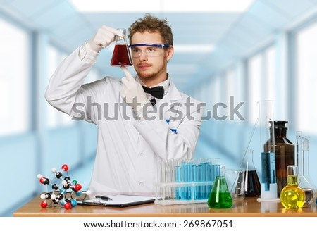 Chemistry. Woman with test tubes in a chemistry lab - stock photo