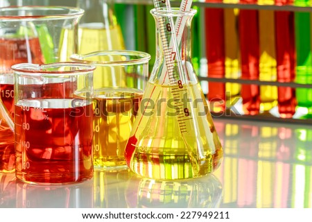 Chemists are measuring the temperature of the solution in a test tube in a laboratory - stock photo