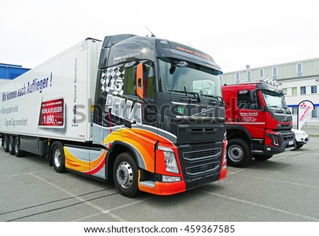 Chemnitz, Germany - October 4, 2015: Modern trucks from manufacturer Volvo on a parking lot in Chemnitz, Germany. The front truck has a refrigerated trailer.