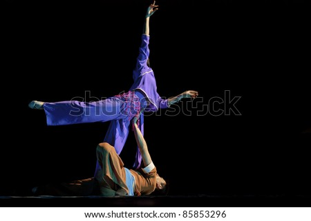 CHENGDU, CHINA- DEC 10: Chinese dancers perform modern dance onstage at JINCHENG theater in the 7th national dance competition of china on Dec 10, 2007 in Chengdu, China.