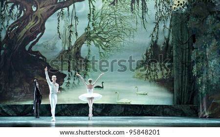 "CHENGDU, CHINA - DECEMBER 25: Russian royal ballet's performance ""Swan Lake"" ballet at Jinsha theater December 25, 2010 in Chengdu, China. - stock photo"