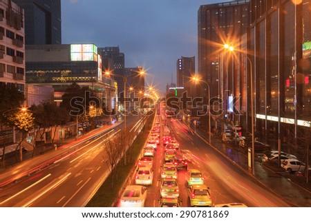 CHENGDU,CHINA - 27 Jan 2015:busy traffic at night at chengdu,china. - stock photo
