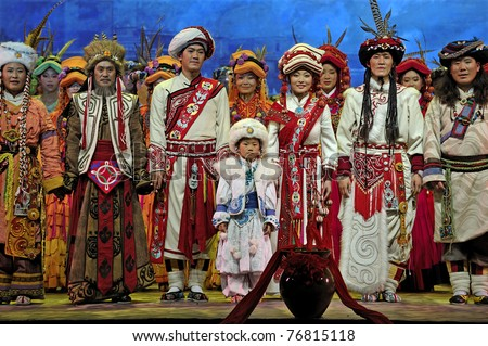 CHENGDU, CHINA - MAY 6: Chinese Qiang ethnic dancers perform folk dance onstage at JiaoZi theater on May 6, 2009 in Chengdu, China.