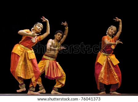 CHENGDU, CHINA  - OCT 24: Indian dancers perform folk dance onstage at Jincheng theater during the festival of India in China on Oct. 24, 2010 in Chengdu, China. - stock photo