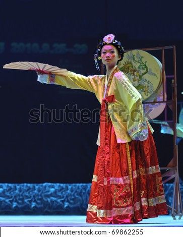 CHENGDU, CHINA - SEPT 28: Korean ethnic dance is performed at the 6th Sichuan Minority Nationality Culture Festival at Jincheng Theater on Sept. 28, 2010 in Chengdu, China.