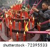 CHENGDU - FEB 5: People burning incense upon the incense altar in temple during chinese new year on Feb 5, 2011 in Chengdu, China. - stock photo