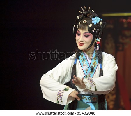 CHENGDU - MAY 28: chinese Sichuan opera performer make a show on stage to compete for awards at Jinsha theater in 25th Chinese Drama Plum Blossom Award competition.May 28, 2011 in Chengdu, China. - stock photo
