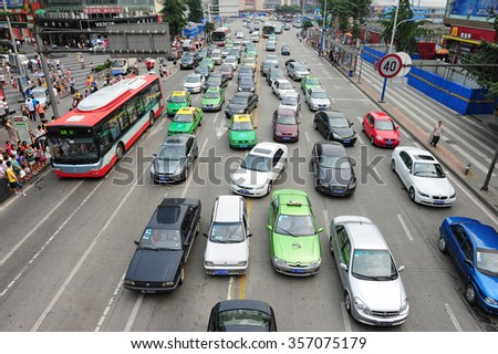 CHENGDU - MAY 18: Traffic jam in Chengdu Central Business District on May 18, 2014 in Chengdu, China. Chengdu is expected to pass the three million vehicles on its roads by the end of the year. - stock photo