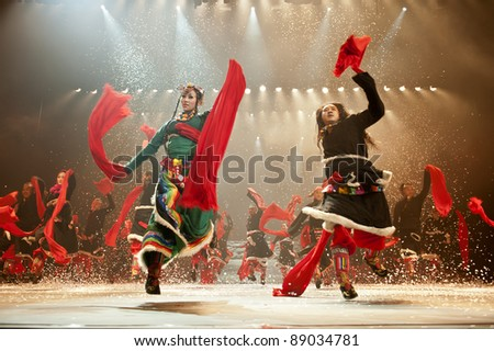 CHENGDU - OCT 27: chinese national dancers perform traditional dance Dynamic Yunnan on stage at Jincheng theater.Oct 27, 2011 in Chengdu, China. - stock photo