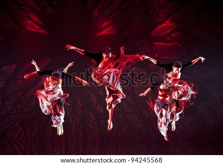 CHENGDU - OCT 17: Chinese Yi national dancers perform contemporary dance on stage at JINCHENG theater on Oct 17, 2011 in Chengdu, China. - stock photo