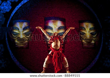 CHENGDU - OCT 17: Chinese Yi national dancers perform folk dance on stage at JINCHENG theater on Oct 17, 2011 in Chengdu, China.