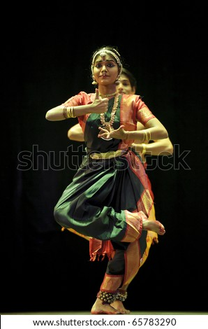 """CHENGDU - OCT 24: Indian folk dance """"Shankara Sri Giri"""" performed by Kalakshetra dance institute of India at JINCHENG theater during the festival of India in china.Oct 24,2010 in Chengdu, China. - stock photo"""