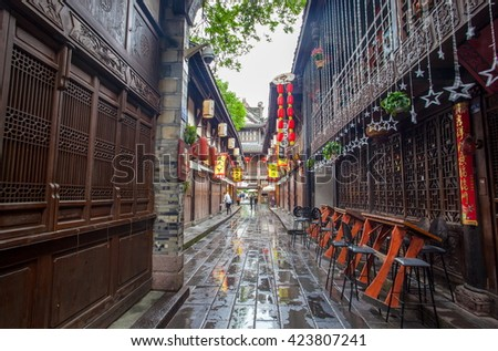 CHENGDU, SICHUAN/CHINA-MAY 14: Jinli old streets scenery-Early morning after the rain on May 14, 2016 in Chengdu, Sichuan, China. The streets are famous tourist spots in Chengdu.  - stock photo