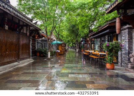 CHENGDU, SICHUAN/CHINA-MAY 14: Kuanzhai Alleys scenery-Early morning after the rain  on May 14, 2016 in Chengdu, Sichuan, China. They are one of old alleys in Chengdu, Sichuan, China.  - stock photo