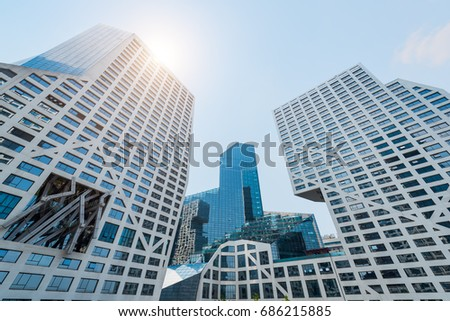 Chengdu, Sichuan Province, China - July 12, 2017: Modern buildings of Raffles City against blue sky and sun