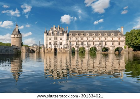 CHENONCEAUX,FRANCE - JULY 7 CIRCA : Chenonceau chateau, built in the XVIth Century over a river, is one of the most famous monument of the Loire Valley, inscribed on the world heritage list of UNESCO. - stock photo