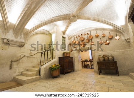 CHENONCEAUX, FRANCE - SEPTEMBER 24, 2011: Castle of Chenonceaux, built in 1513 is located on the Loire Valley of France. Photo of one of the fabulous kitchens constructed in the piers of the bridge.  - stock photo