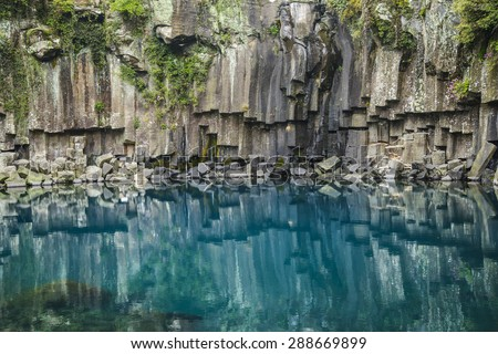 Cheonjeyeon No. 1 cascade. Cheonjeyoen falls (means the pond of God) consists of 3 falls. A variety of plant life, inclued Psilotum nudun, thrives around the falls.  - stock photo