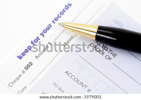 cheque with pen for business concept